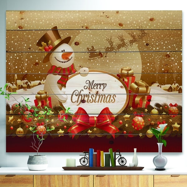 Designart 'Christmas Sowman on Gold with Flying Reindeer' Print on Natural Pine Wood - yellow & gold
