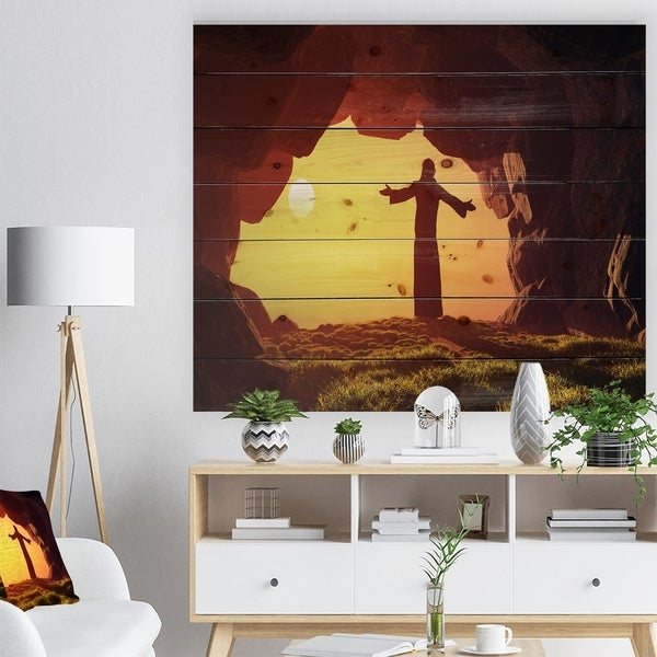 Designart 'Man Praying in Cave Under Sunset' Religious Contemporary Print on Natural Pine Wood - Brown