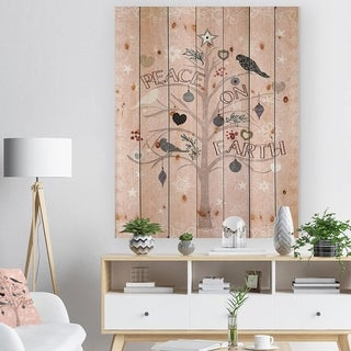 Designart 'The Embellished Christmas Tree, Peace on Earth' Print on Natural Pine Wood - Pink