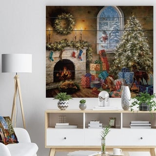 Designart 'Christmas Eve with presents by fire place' Print on Natural Pine Wood - Red