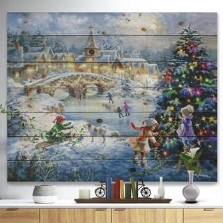 Designart 'Christmas tree decorating sledding children' Print on Natural Pine Wood - Blue