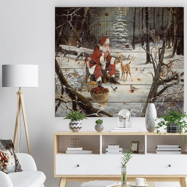 Designart 'Santa Claus with deer in snowy woods' Print on Natural Pine Wood - White