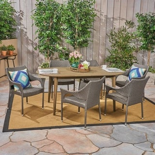 Fayette Outdoor 7 Piece Acacia Wood Dining Set with Stacking Wicker Chairs by Christopher Knight Home