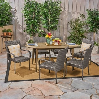 Elderon Outdoor 7 Piece Acacia Wood Dining Set with Stacking Wicker Chairs by Christopher Knight Home