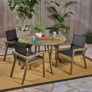 Link to Lockett Outdoor Acacia Wood 5 Piece Round Dining Set with Mesh Seats by Christopher Knight Home Similar Items in Outdoor Dining Sets