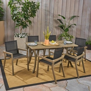 Link to Shanter Outdoor Acacia Wood 7 Piece Dining Set with Mesh Seats by Christopher Knight Home Similar Items in Outdoor Dining Sets