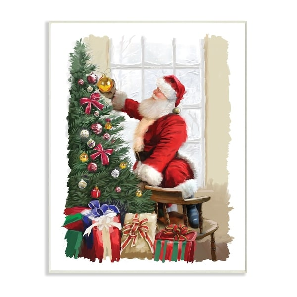 the stupell home dcor collection holiday santa decorating christmas tree with gifts wall plaque art