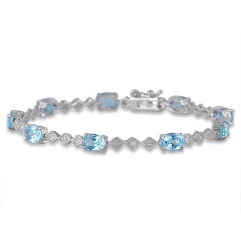 10 Carat Oval Blue Topaz and Diamond Bracelet in Rhodium Plated Brass