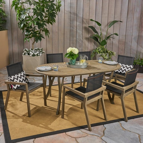 Arletta Outdoor Acacia Wood 6 Seater Patio Dining Set with Mesh Seats by Christopher Knight Home. Opens flyout.