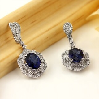 Fancy Oval Shaped 5 9/10ct Royal Blue Sapphire and 2 1/3ct TDW Diamond Halo Dangle Earrings in 18K Gold by Auriya