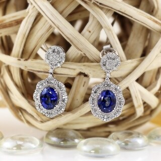 Fancy Oval Shaped 8 1/5ct Royal Blue Sapphire and 1 5/8ct TDW Diamond Halo Dangling Earrings in 18K Gold by Auriya