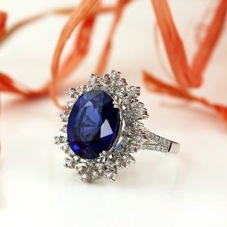 18K Gold Princess Diana Inspired 8 3/4ct Royal Blue Sapphire and 9/10ct TDW Halo Diamond Engagement Ring by Auriya