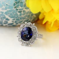 18K Gold Princess Diana Inspired 7ct Royal Blue Sapphire and 1ct TDW Halo Diamond Engagement Ring by Auriya