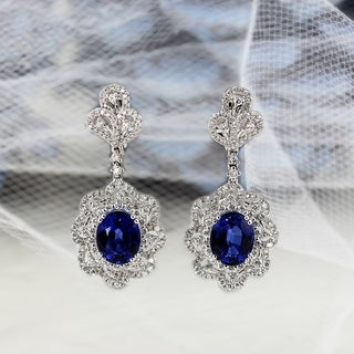 Fancy Oval Shaped 8 1/5ct Royal Blue Sapphire and 2ct TDW Diamond Halo Earrings in 18K Gold by Auriya