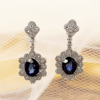 Fancy Oval Shaped 5 3/4ct Royal Blue Sapphire and 1 1/4ct TDW Dangling Diamond Halo Earrings in 18K Gold by Auriya
