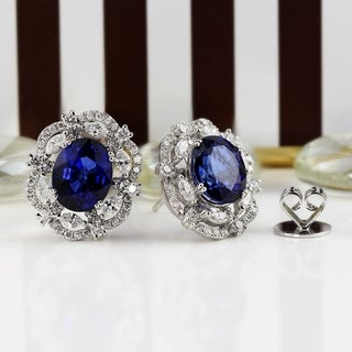 Fancy Oval Shaped 7 1/2 cttw Royal Blue Sapphire and 1 3/4ct TDW Diamond Halo Earrings in 18K Gold by Auriya