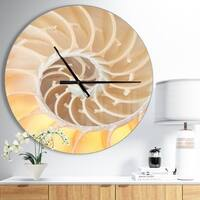 Designart 'Golden Nautilus Shell Pattern' Oversized Coastal Metal Clock