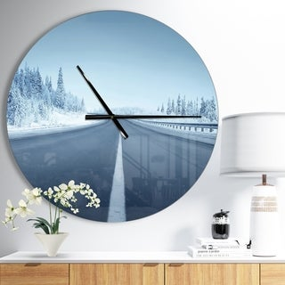 Designart 'Road in winter forest' Oversized Landscapes Wall CLock
