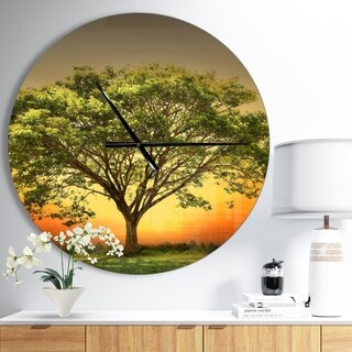Designart 'Green Tree against Setting Sun' Oversized Traditional Wall CLock