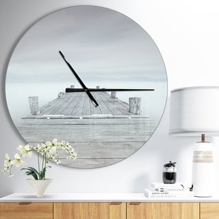 Designart 'Wooden Pier in Cloudy Mood' Oversized Landscapes Wall CLock