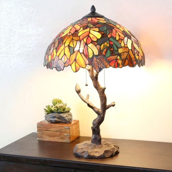 "Copper Grove Eugenia Stained Glass 24.5-inch Tiffany-style Lamp with Tree Trunk Base - 16""L x 16""W x 24.50""H. Opens flyout."