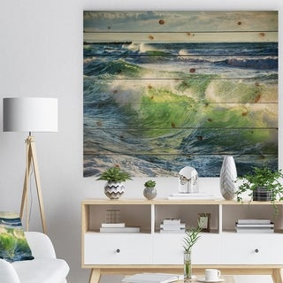 Designart 'Sunrise and Shining Waves in Ocean' Beach Photo Print on Natural Pine Wood - Blue