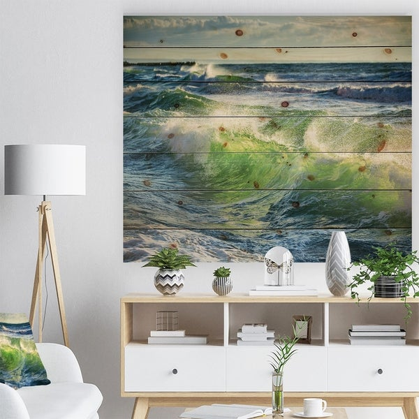 Designart 'Sunrise and Shining Waves in Ocean' Beach Photo Print on Natural Pine Wood - Blue