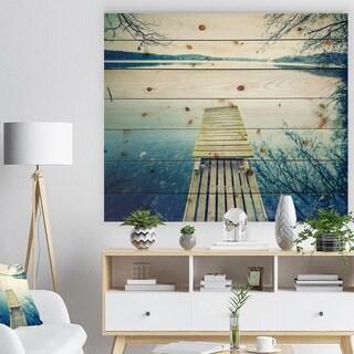 Designart 'Sunset Over Tranquil Lake' Bridge Print on Natural Pine Wood - Blue