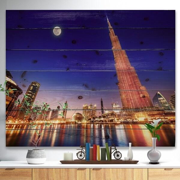 Designart 'Burj Khalifa Night Landscape' Cityscape Print on Natural Pine Wood - Multi-color