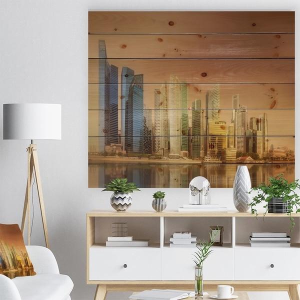 Designart 'Singapore Skyline under Brown Sky' Cityscape Print on Natural Pine Wood