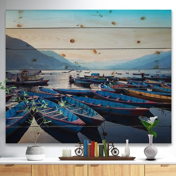 Designart 'Blue Wooden Boats in Lake' Boat Print on Natural Pine Wood - Blue