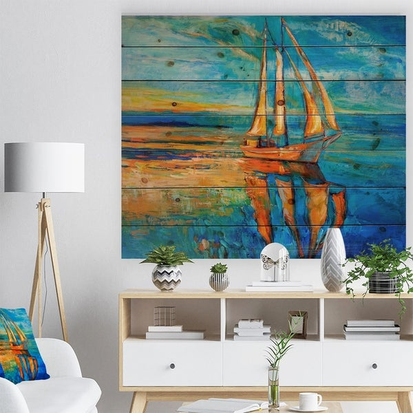Designart 'Sail Ship at Sunset in Blue Sky' Sea & Shore Painting Print on Natural Pine Wood