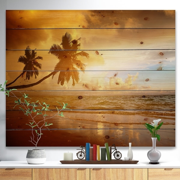Designart 'Beautiful Palms at the Caribbean Beach' Seascape Print on Natural Pine Wood - Blue