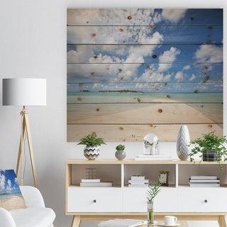 Designart 'Serene Maldives Beach under Clouds' Seascape Print on Natural Pine Wood - Blue