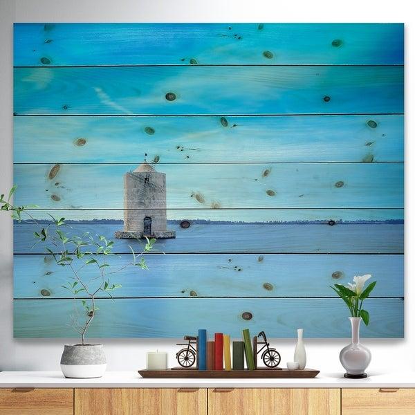 Designart 'Old Spanish Windmill in Blue Lagoon' Seashore Print on Natural Pine Wood