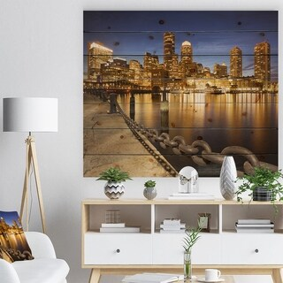 Designart 'USA Skyline from Fan Pier at Night' Cityscape Print on Natural Pine Wood - Multi-color