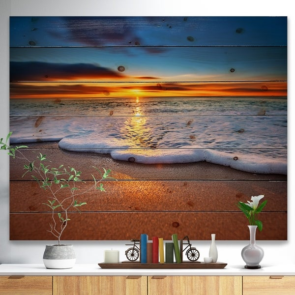 Designart 'Sunrise light shining from Blue Sky' Landscapes Sea & Shore Print on Natural Pine Wood - Brown