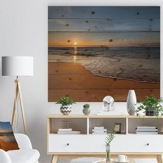Designart 'West Cost Sunset Over the Sea' Landscapes Sea & Shore Print on Natural Pine Wood - Brown