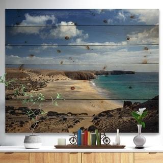 Designart 'Bright Seashore with Blue Waters' Seashore Print on Natural Pine Wood