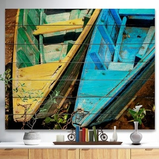 Designart 'Wooden Boats on Lake Phewa' Boat Print on Natural Pine Wood - Multi-color
