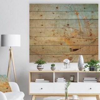 Designart 'Old Sailing Ship in Sunlight' Seascape Print on Natural Pine Wood - Blue