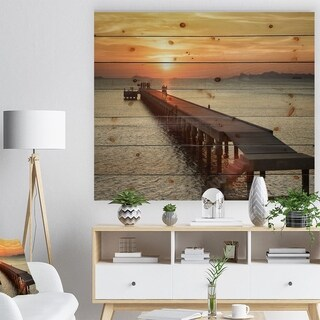 Designart 'Boat Pier at Sunset' Bridge Print on Natural Pine Wood - Multi-color