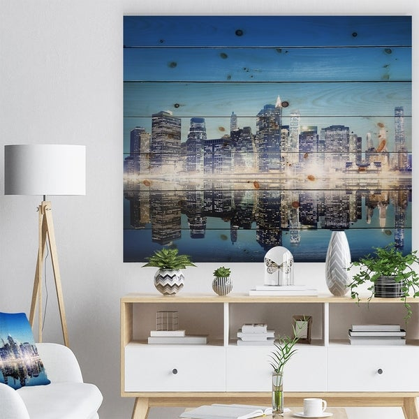 Designart 'Skyscraper on New York City' Cityscape Print on Natural Pine Wood - Multi-color