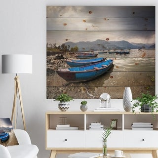 Designart 'Blue Boats in Pokhara Lake' Boat Print on Natural Pine Wood - Blue