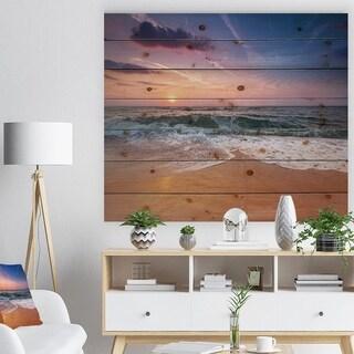 Designart 'Sunrise light shining on ocean waves' Landscapes Sea & Shore Print on Natural Pine Wood - Brown