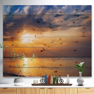 Designart 'West Cost Sunrise Over The seas' Landscapes Sea & Shore Print on Natural Pine Wood - Brown