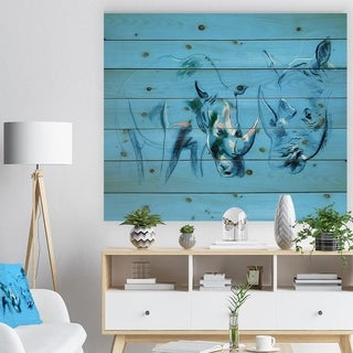 Designart 'Rhinoceros painting in Blue Background' Animals Sketch Painting Print on Natural Pine Wood