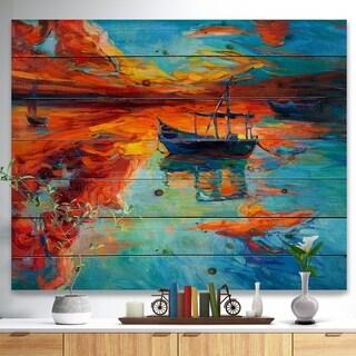 Designart 'Fishing Sailing Boat at Red Sunset' Sea & Shore Painting Print on Natural Pine Wood - Blue