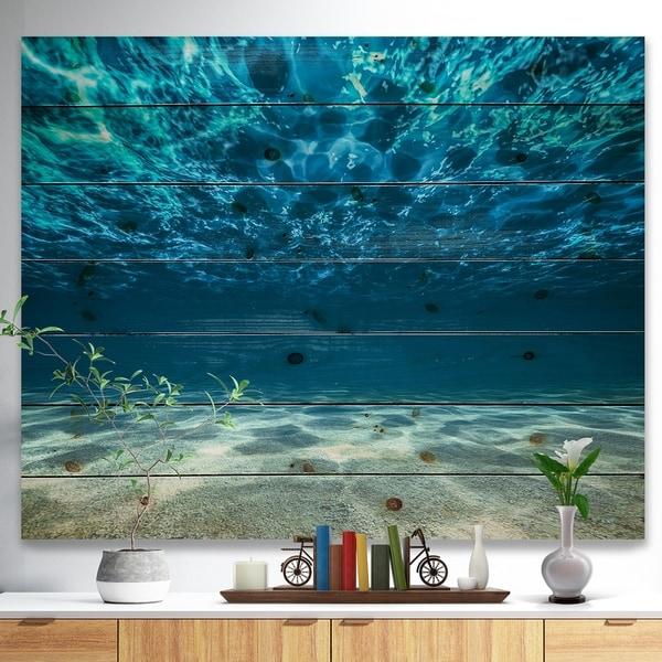 Designart 'Ocean Bottom Beneath the Surface' Sea & Shore Print on Natural Pine Wood - Blue
