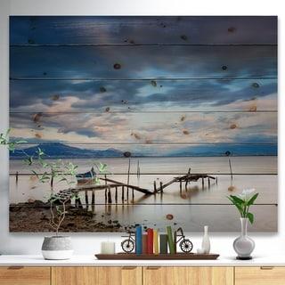 Designart 'Magic Sunrise and Wooden Pier' Landscapes Sea & Shore Print on Natural Pine Wood - Blue